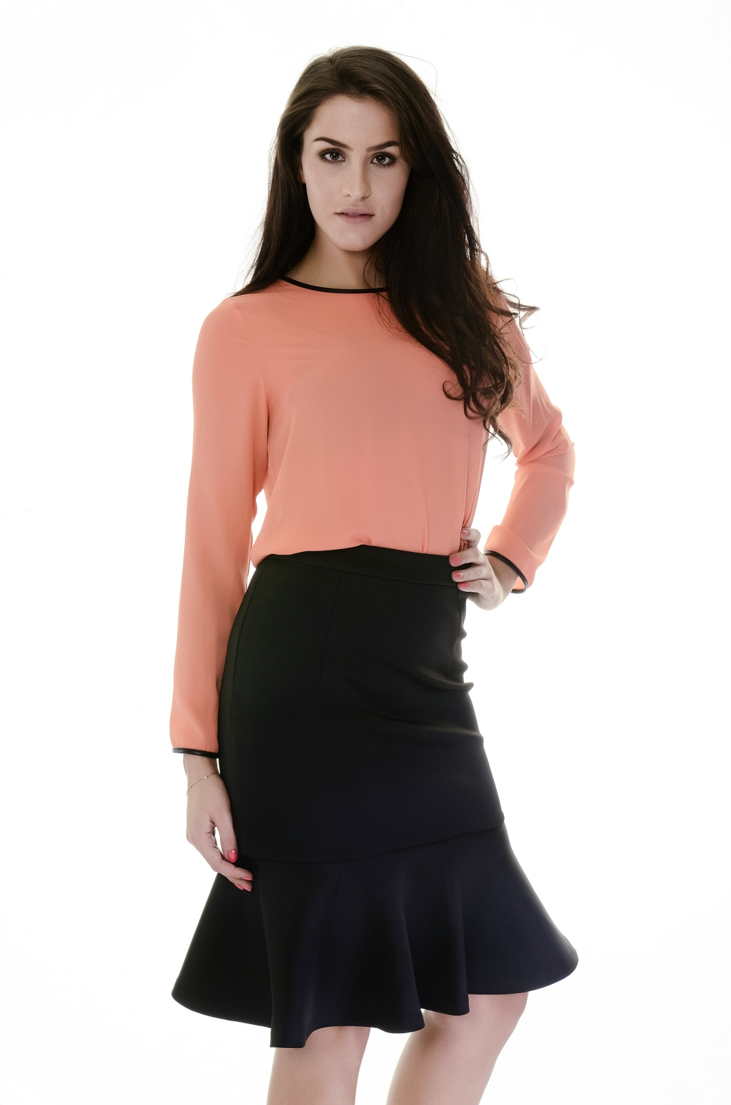 peach top with black peplum skirt